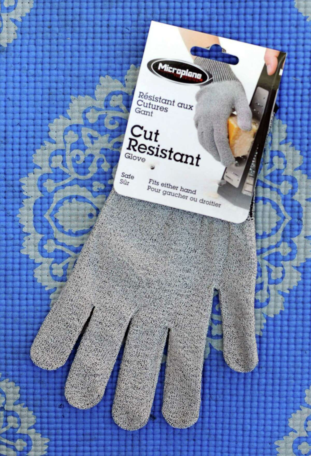 Cut-resistant gloves are a sure way to protect fingertips for anyone using a mandolin slicer.