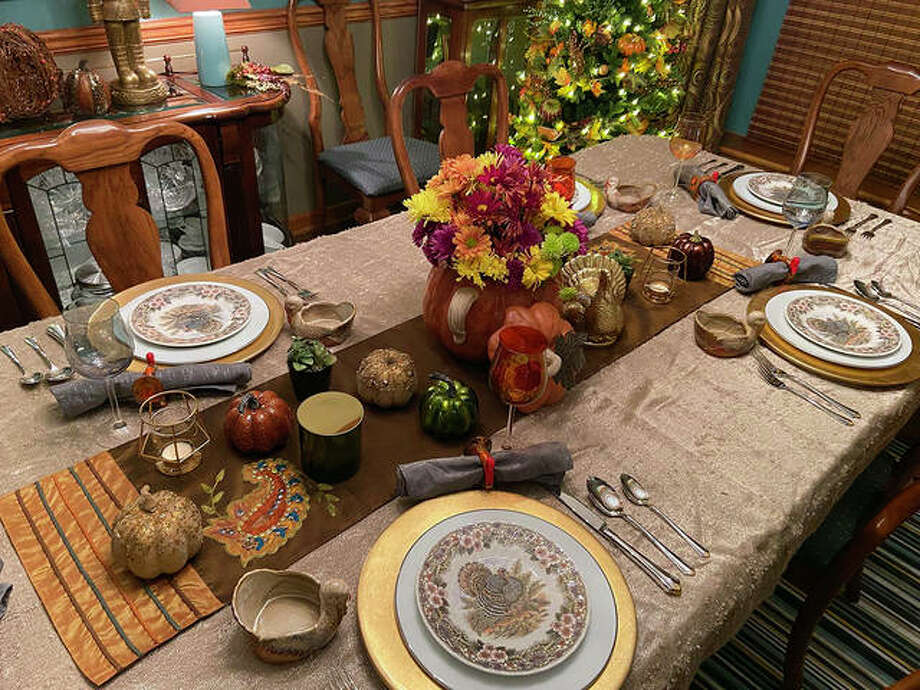Even though they don't plan on eating in their dining room this Thanksgiving, Kimberly Collins laid out her dining room table in holiday style. Collins is a Collinsville resident and is the public relations liaison for the Collinsville School District. Photo: Courtesy Of Kimberly Collins