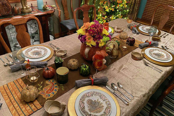 Even though they don't plan on eating in their dining room this Thanksgiving, Kimberly Collins laid out her dining room table in holiday style. Collins is a Collinsville resident and is the public relations liaison for the Collinsville School District.