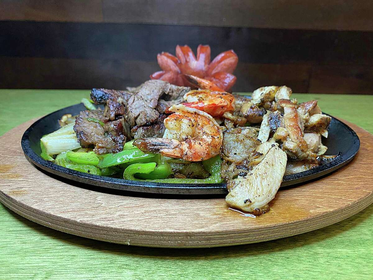 Parrillada plates include La Original with beef, chicken, shrimp and sausage at Tia's Taco Hut, a new Mexican restaurant on Chase Hill Boulevard.