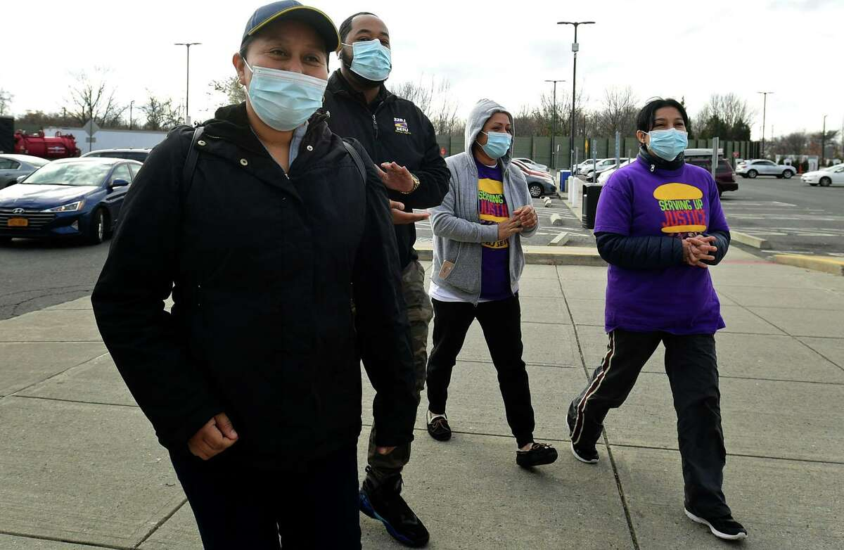Organizers and members of the Service Employees International Union (SEIU) local 38BJ walk with McDonald' s employee Maria Gonsalez at the Northbound I-95 service plaza Wednesday, November 25, 2020, in support of McDonald's workers that were on a one day strike at the service plaza restaurant in Darien, Conn. The unio walked striking McDonald's workers back to their jobs after the 24 hour strike over lack of paid sick days.