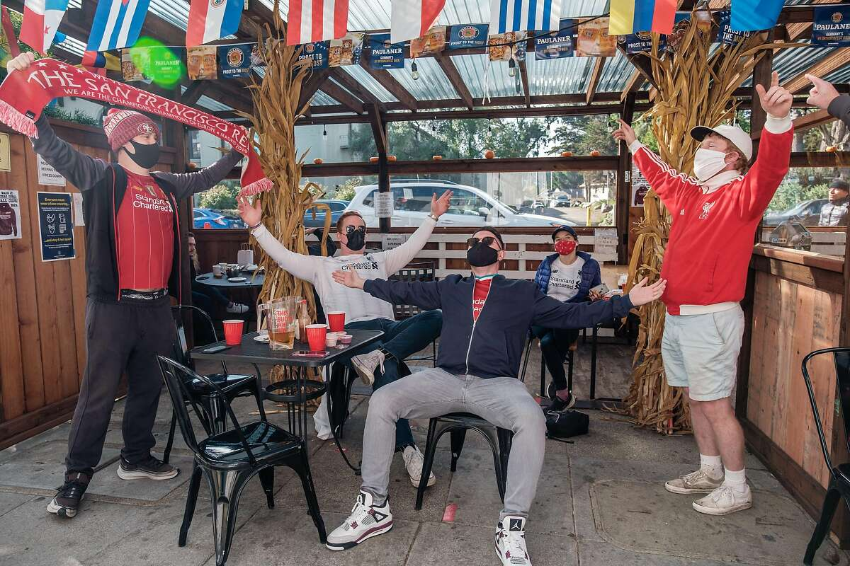 Left: Fans of Liverpool F.C. celebrate at the end of a game at Kezar Pub, a sports bar in San Francisco on Sunday, November 22, 2020.