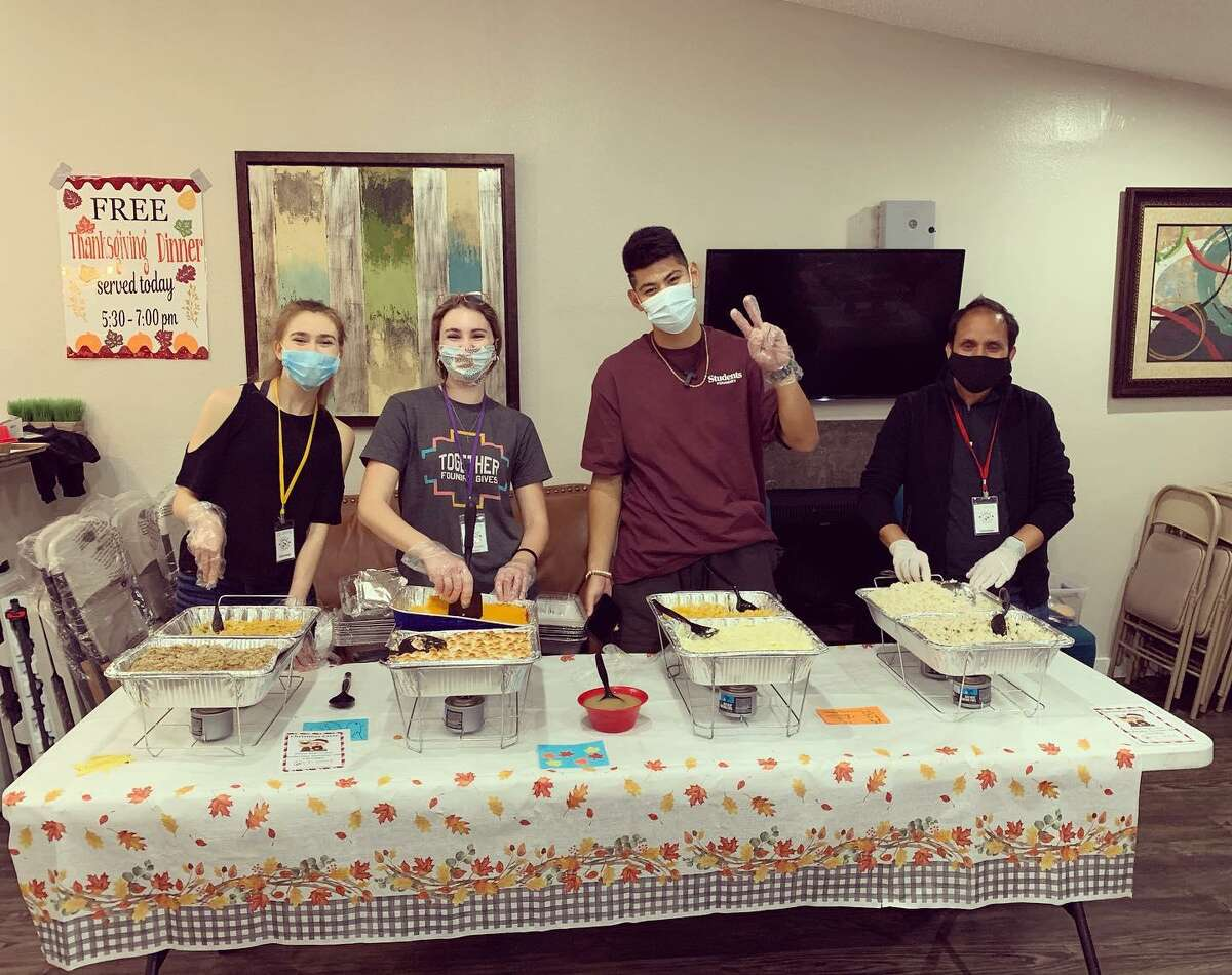 Cy-Hope volunteers served Thanksgiving meals in the community with volunteers and fried turkeys from The Backyard Grill.