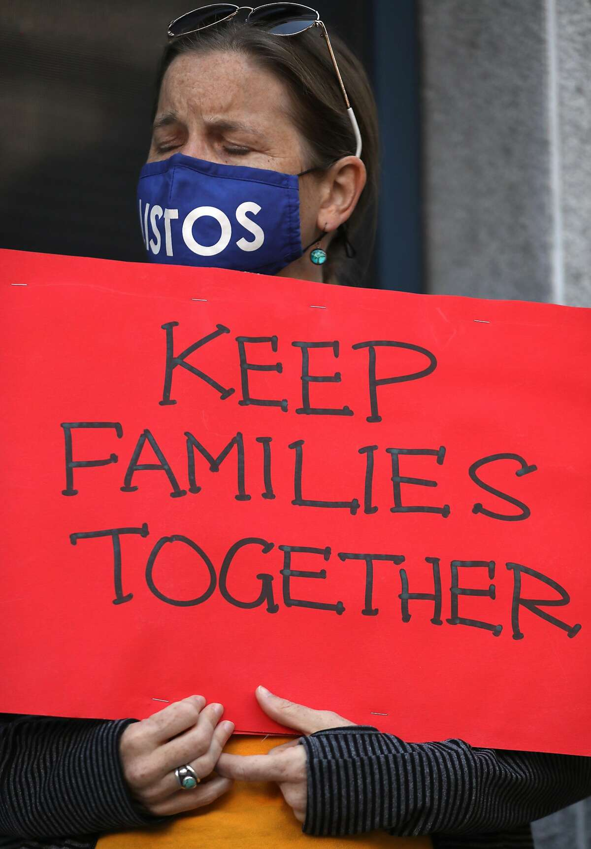 Supporters pray against the deportation of Hugo Aguilar in front of the U.S. immigration office on Tuesday, Oct. 27, 2020, in San Francisco, Calif. Hugo Aguilar has recently been ordered deported in the next 30 days.