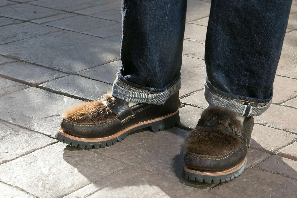 Jeremy Smith, one of the owners of Standard & Strange, wears a pair of designer shoes outside his store in Oakland, Calif., on Nov. 24, 2020. The retail clothing shop will donate any revenue made during their Black Friday sale to benefit the homeless.