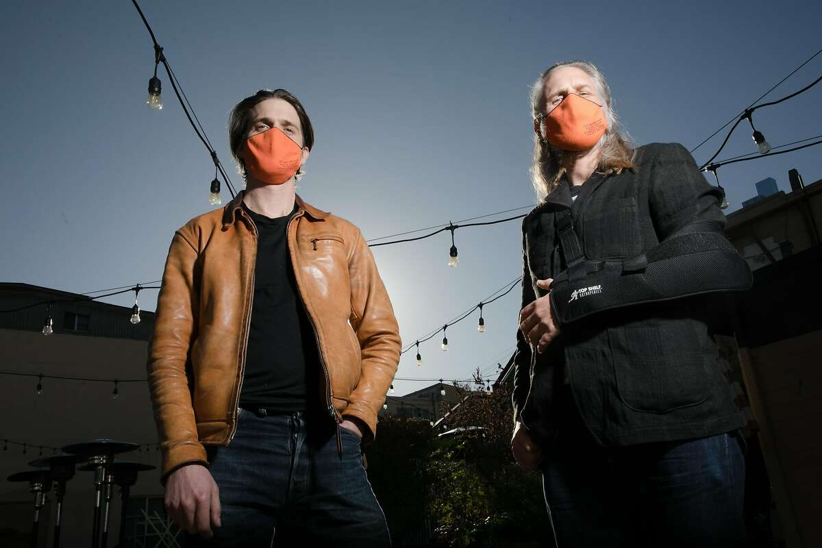 Neil Berrett and Jeremy Smith, left to right, the owners of Standard & Strange, photographed outside their store in Oakland, Calif., on Nov. 24, 2020. The retail clothing shop will donate any revenue made during their Black Friday sale to benefit the homeless.