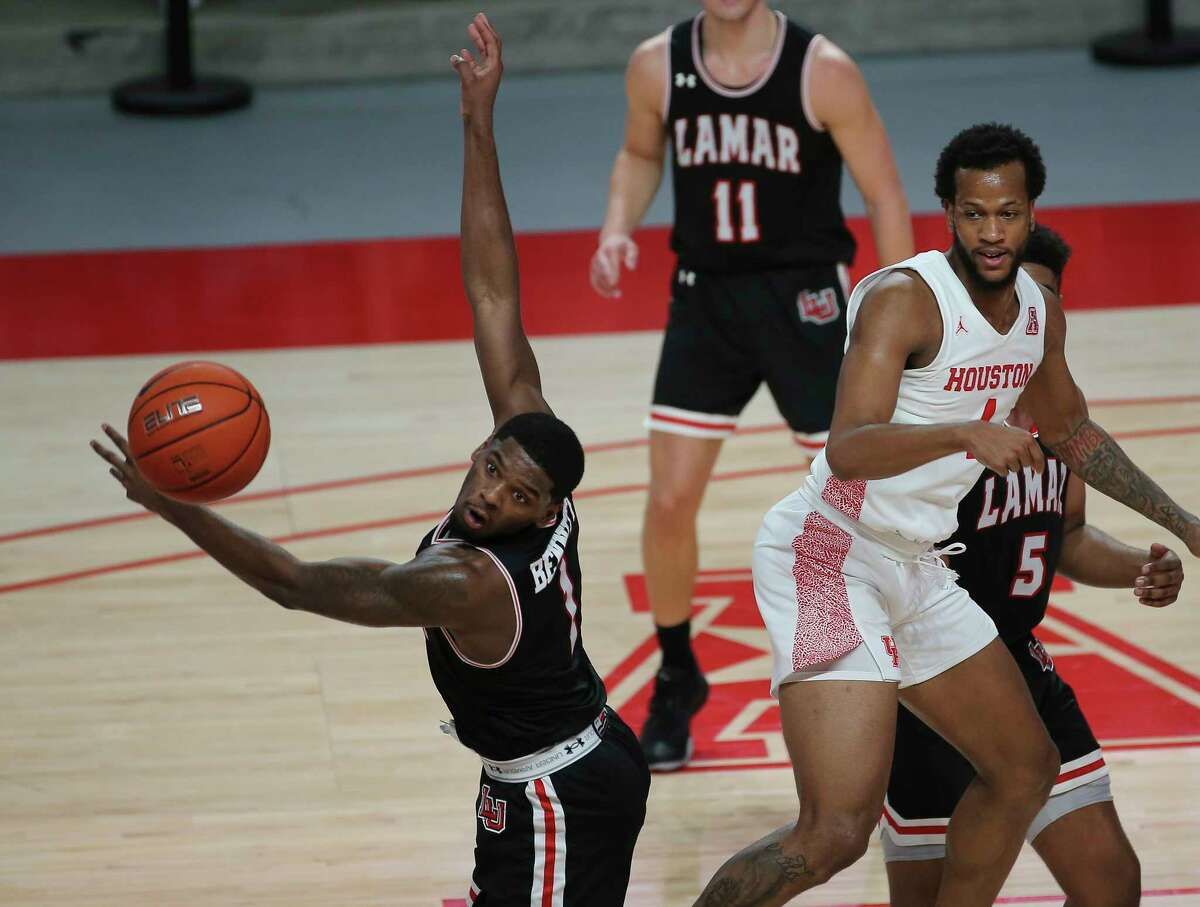 Lamar Cardinals guard Quinlan Bennett (1) watches the Houston Cougars forward Justin Gorham's (4) pass go beyong his capability to interrupt during the first half of a American Athletic Conference game Wednesday, Nov. 25, 2020, at Fertitta Center in Houston.