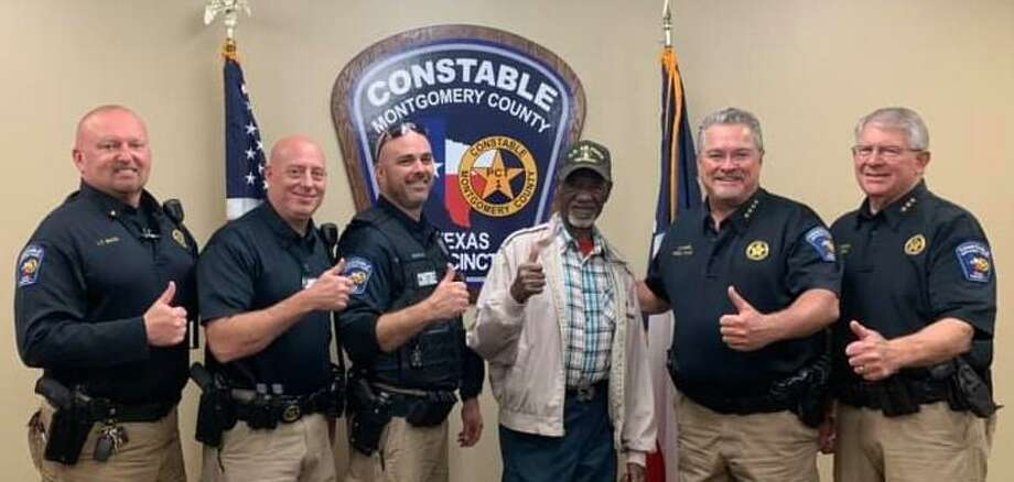 The Montgomery County Precinct 1 Constable's Office paid for the Thanksgiving meal of Willis resident John Perkins. Pictured Nov. 23 giving a thumbs up at Precinct 1's station in Willis, from right to left, Lt. Wesley Mack, Lt. Brian Luly, Deputy Paul Bostwick, Perkins, Constable Philip Cash and Chief Deputy Don Fullen. Photo: Courtesy Of The Montgomery County Precinct 1 Constable's Office