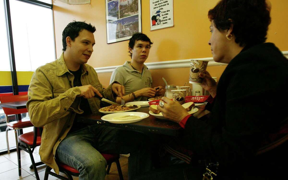 Moises Castillo, 29, left, and his brother Juan Carlos Castillo, 23, share a conversation with their mother, Gloria Ines Giron. Deeper conversations help people become explicable to each other and themselves.
