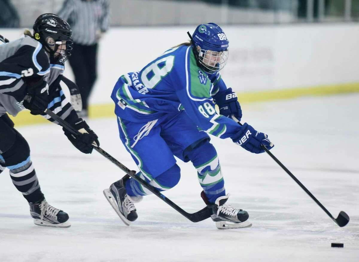 The Connecticut Whale's Alyssa Wohlfeiler (88) makes a break around a defender during an NWHL game against Buffalo in 2016.