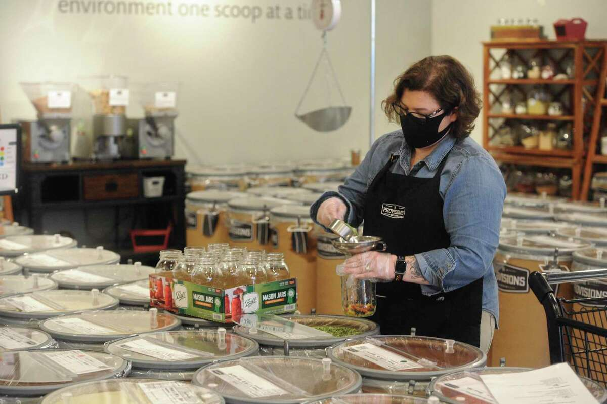 Isabelle Duval, assistant manager of BD Provisions, in Newtown, Conn, creates soup in a jar on Wednesday afternoon, November 25, 2020. The store sells dry goods by the barrel.