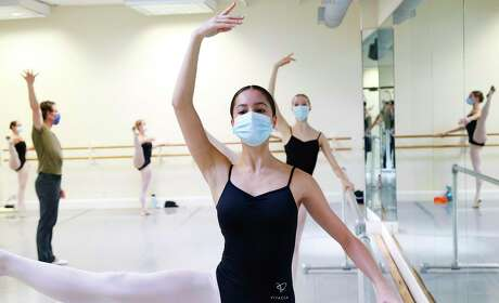 Ballet students take precautions during class. Masks make a difference in combating the spread of COVID-19, a young Houstonian notes in his poem.