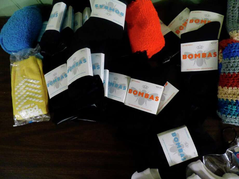 ECHO His Love's Safe Harbor shelter program was gifted socks by Bombas, an apparell company which gifts clothing to homeless shelters. (Scott Fraley/News Advocate)