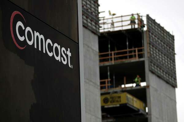 The Comcast logo is displayed on the exterior of a Comcast office on Jan. 23, 2020, in San Francisco, Calif.