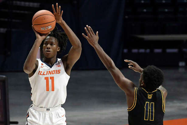 Illinois' Ayo Dosunmu (11) shoots as North Carolina's Tyler Maye (11) defends during the first half of an NCAA college basketball game, Wednesday, Nov. 25, 2020, in Champaign, Ill.