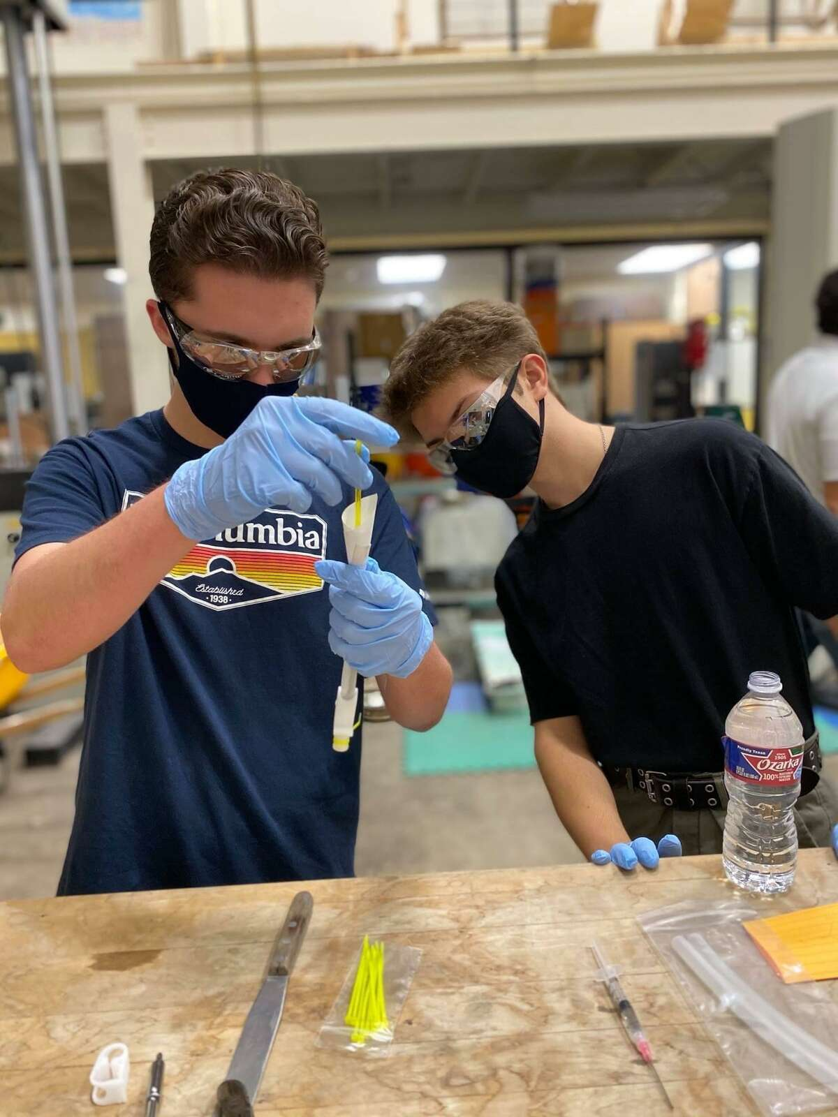 Austin Havard, left, and Lucas Mason prepare the final samples of concrete to be sent to the International Space Station. The two students from Lumberton High School won a competition to send an experiment to the international space station as part of the Student Spaceflight Experiments Program.