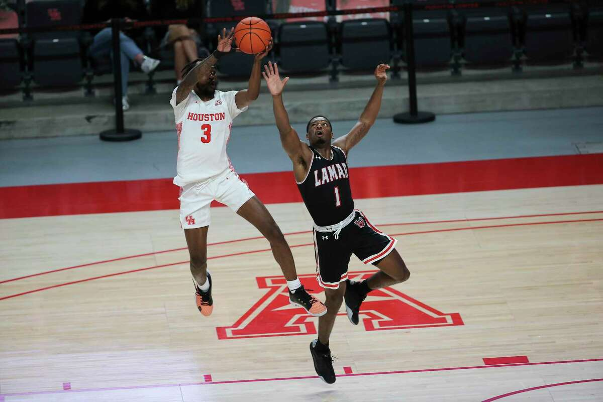 Houston Cougars guard DeJon Jarreau (3) steals a long pass for Lamar Cardinals guard Quinlan Bennett (1) during the second half of a American Athletic Conference game Wednesday, Nov. 25, 2020, at Fertitta Center in Houston.