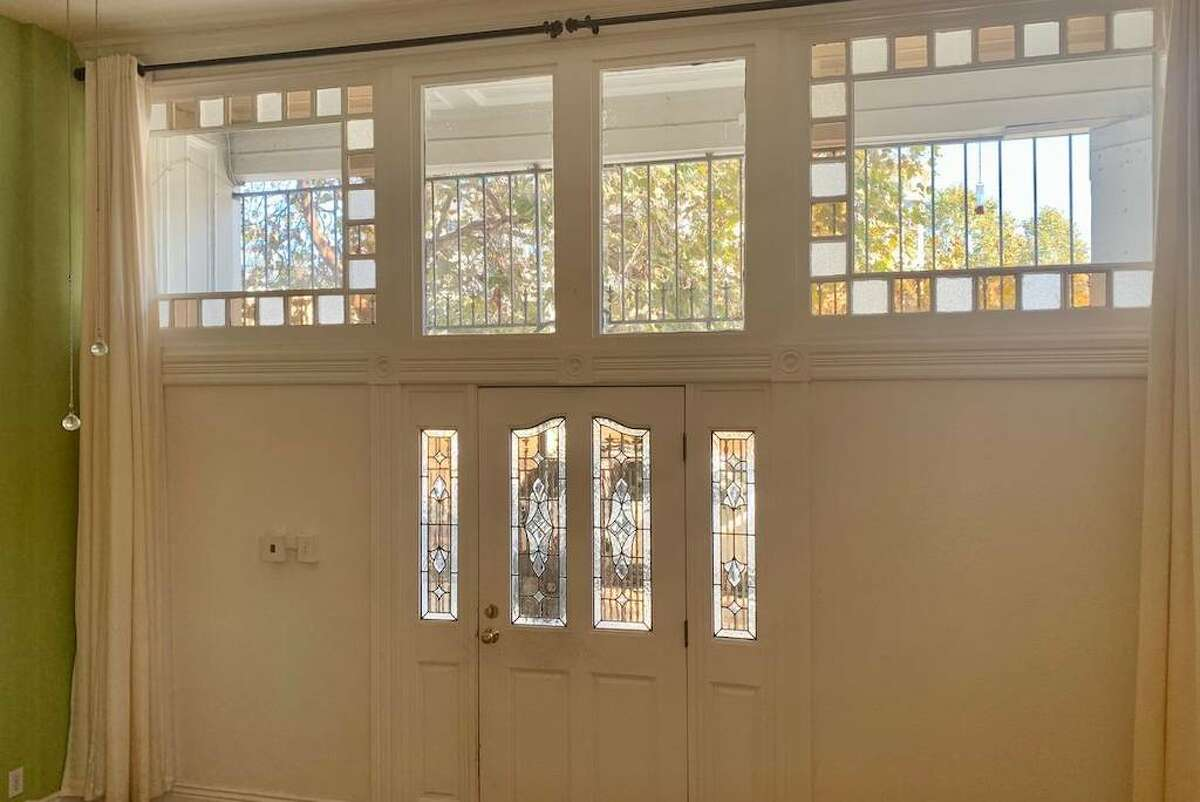 There are original stained glass windows above and around the front door, according to the listing, allowing in lots of southern and eastern light.