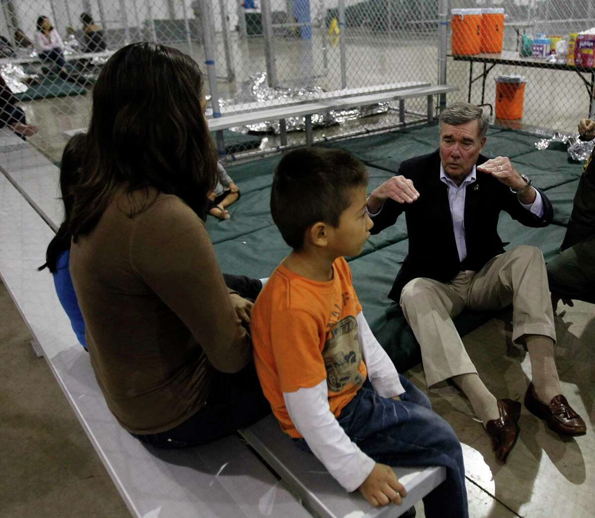 Gil Kerlikowske, former Commissioner of U.S. Customs and Border Protection, sat on the floor to speak with an immigrant family held in a McAllen processing center in 2015. Kerlikowske lauds President-elect Joe Biden's pick for Secretary of Homeland Security, Alejandro Mayorkas.