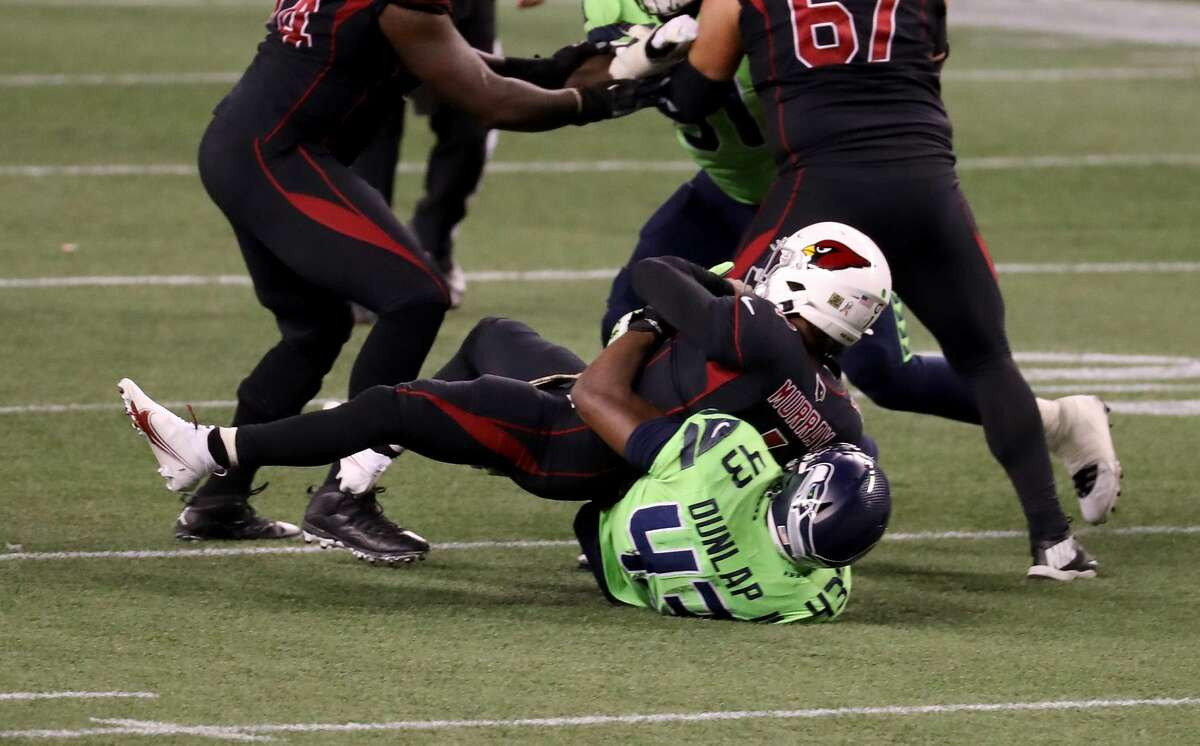 SEATTLE, WASHINGTON - NOVEMBER 19: Carlos Dunlap #43 of the Seattle Seahawks sacks Kyler Murray #1 of the Arizona Cardinals in the final minute of their game at Lumen Field on November 19, 2020 in Seattle, Washington. (Photo by Abbie Parr/Getty Images)