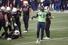 SEATTLE, WASHINGTON - NOVEMBER 19: Carlos Dunlap #43 of the Seattle Seahawks reacts after sacking Kyler Murray #1 of the Arizona Cardinals at Lumen Field on November 19, 2020 in Seattle, Washington. (Photo by Abbie Parr/Getty Images)