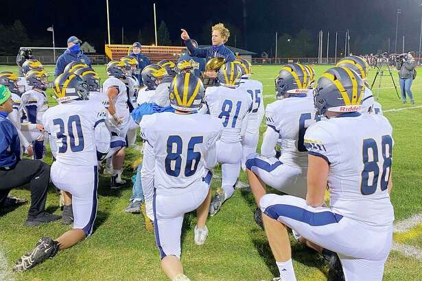 Manistee football coach Troy Bytwork, pictured addressing his team after a victory over Ludington this season, was named regional coach of the year by the Michigan High School Football Coaches Association. (News Advocate file photo)
