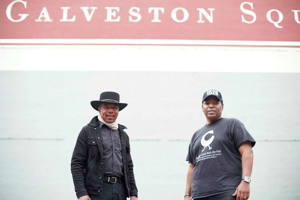 Mural artist Reginald Adams, left, and Sam Collins, a local historian, stand at the location where a mural honoring Juneteenth is proposed for display in Galveston's Strand Historic District on Monday, Nov. 23, 2020.