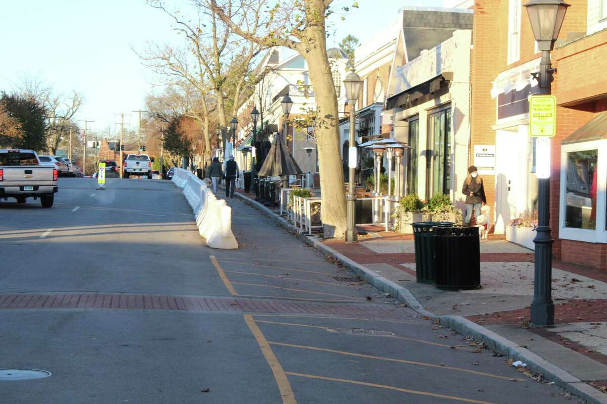 The barriers that line Elm Street in New Canaan will remain into the winter as the town works with local restaurants to keep them operating amid closures and capacity restrictions related to the COVID-19 pandemic.