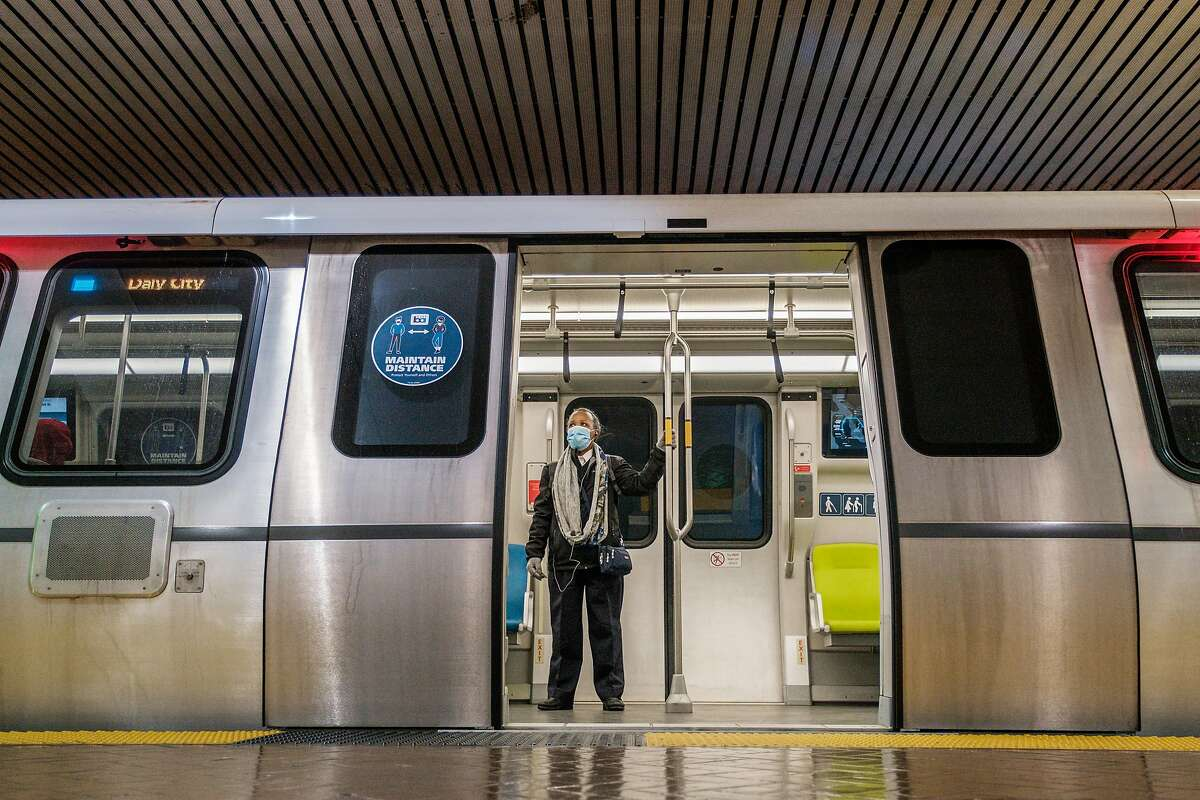 A passenger stands on a Bart train at the Powell Street Station in San Francisco on Wednesday, November 25, 2020.
