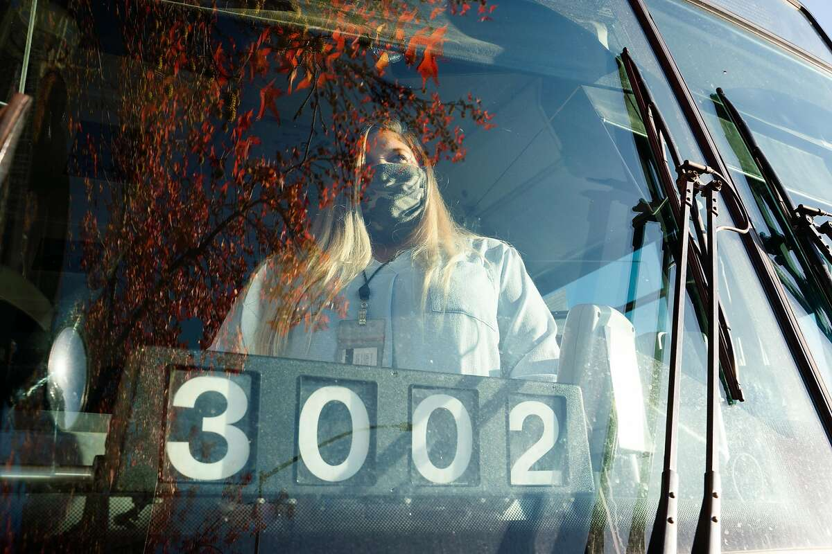 JorDann Crawford, shown at a bus stop in Novato, will lose her job, as will 87 other Golden Gate Transit drivers.