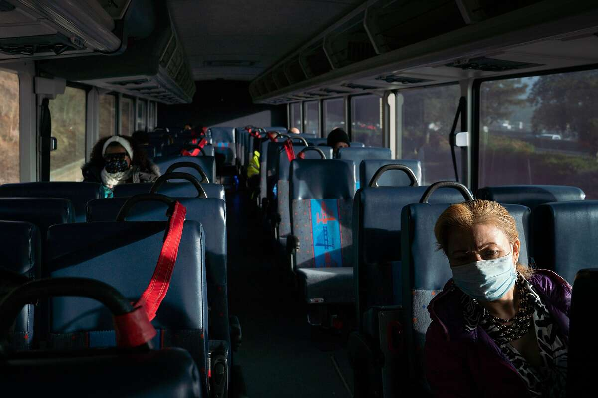 Socially distanced passengers ride a Golden Gate Transit bus. The troubled transit district is losing at least $1 million per week.