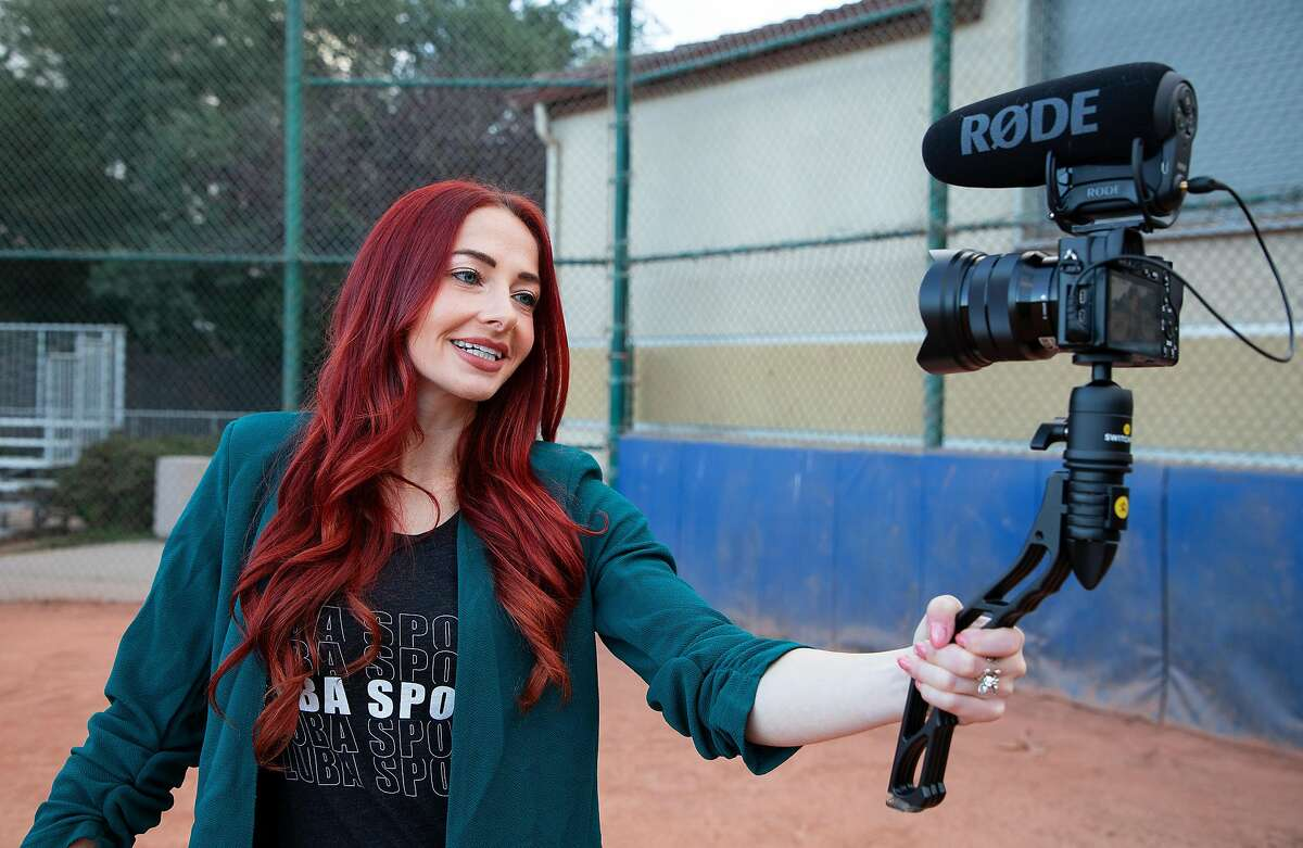 Rachel Luba records a client's vlog in Seaside, Calif. Luba became a sports agent, which can be a bit like one of her original career goals - fighter pilot.