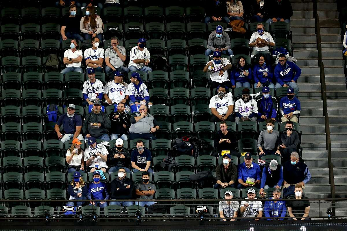 ARLINGTON, TEXAS - OCTOBER 23: Fans watch Game Three of the 2020 MLB World Series between the Los Angeles Dodgers and the Tampa Bay Rays at Globe Life Field on October 23, 2020 in Arlington, Texas. ~~