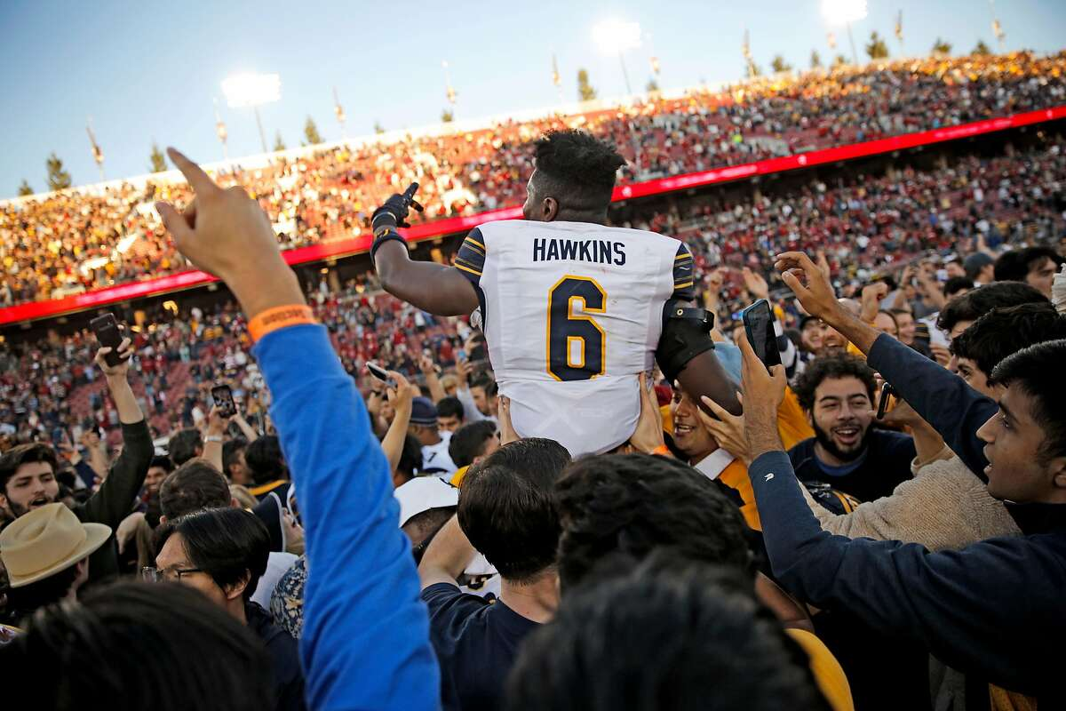 Cal's Jaylinn Hawkins, who had an interception and sack, gets a ride of the field after the Bears' win at Stanford last year.