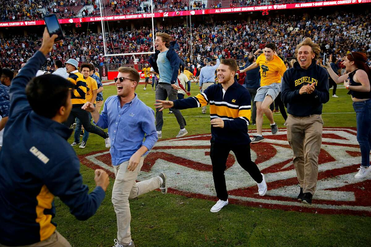 Cal fans run on the Stanford Stadium field after the 122nd Big Game last year. Cal won 24-20, scoring the winning touchdown with less than two minutes to play.