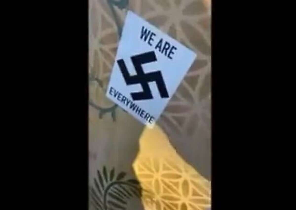 This screenshot of an Instagram video shows one of the stickers placed on public and private property in downtown Fairfax. The video was captured by Fairfax resident Noah Mohan, 21, who told The Chronicle that he approached the man with the stickers because he did not want that type of ideology in the city he was raised.