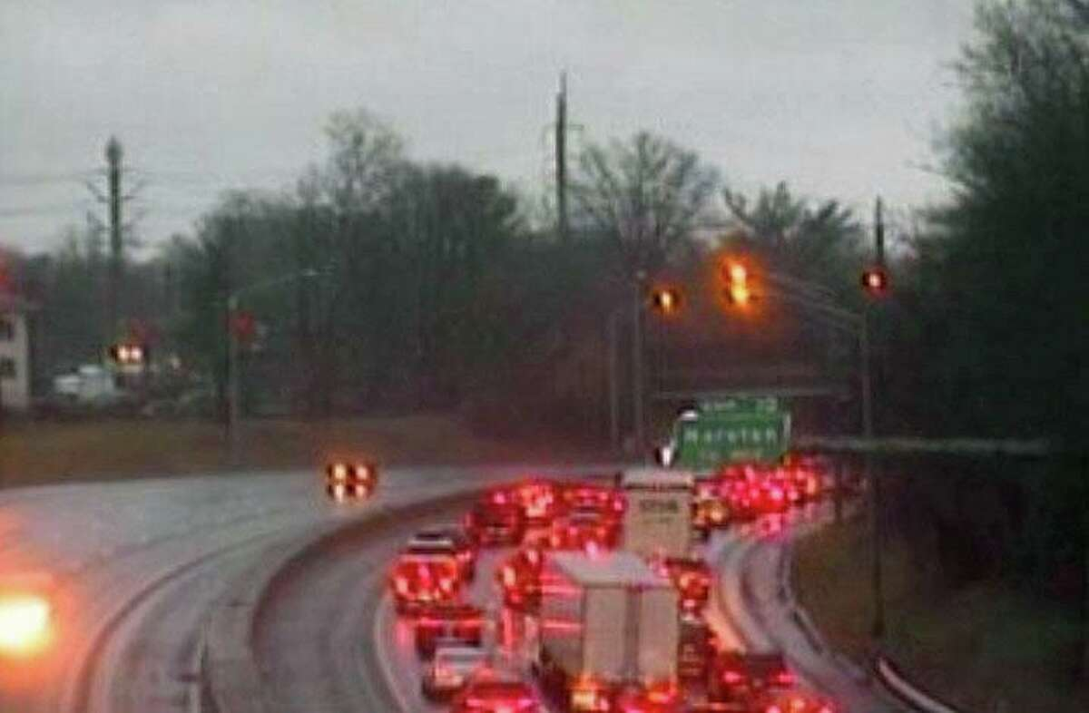 Traffic backed up on I-95 in Darien, Conn., after a tractor-trailer jackknifed on Thursday, Nov. 26, 2020.