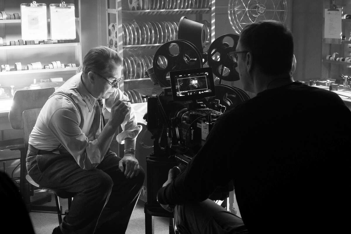 """A behind-the-scenes shot of Gary Oldman in """"Mank."""" The actor portrays """"Citizen Kane"""" scribe Herman Mankiewicz as a difficult genius."""