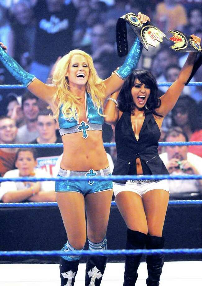 "Wrestler ""Michelle McCool"" left, celebrates in the rings with a WWE supporter Layla El following her victory over opponent ""Kelly Kelly"" (not in this photo,) during their match in the WWE ""Smackdown"" presentation at the Times Union Center onTuesday, August 31, 2010, in Albany, NY.    (Luanne M. Ferris / Times Union ) Photo: Luanne M. Ferris"