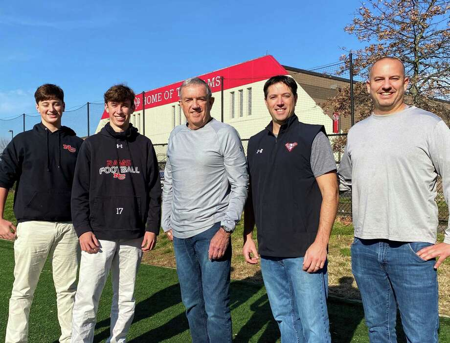Taylor, Reid, Tom, Kevin and Mike Brown at New Canaan High School. Taylor and Reid are currently on the Rams football team while Mike and Kevin are former players and Tom is a longtime official. Photo: Scott Ericson / Hearst Connecticut Media / Connecticut Post