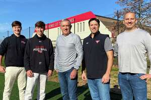 Taylor, Reid, Tom, Kevin and Mike Brown at New Canaan High School. Taylor and Reid are currently on the Rams football team while Mike and Kevin are former players and Tom is a longtime official.