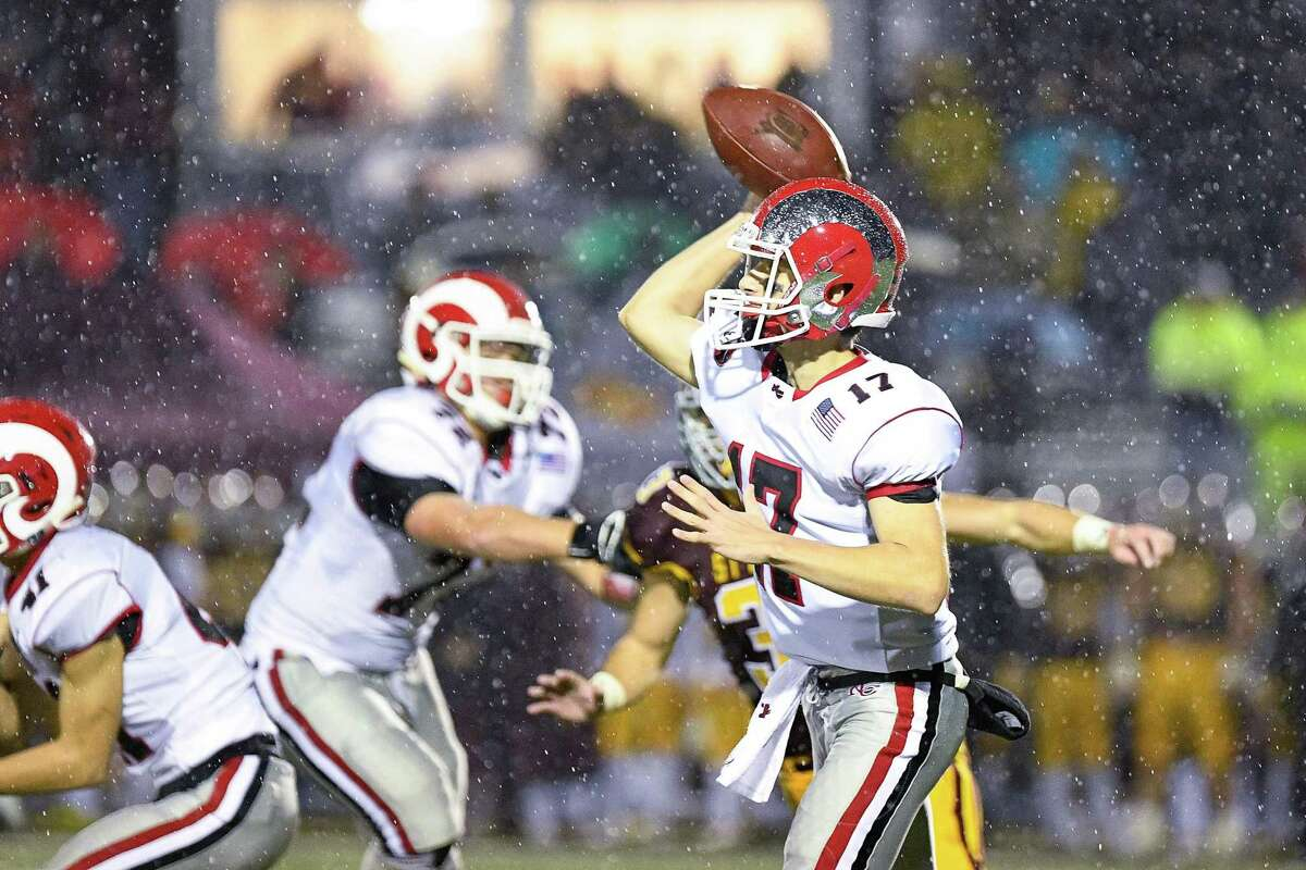 New Canaan quarterback Reid Brown against St. Joseph high in the CIAC Class L Semi-final game at Bunnell High School, Monday December 9, 2019