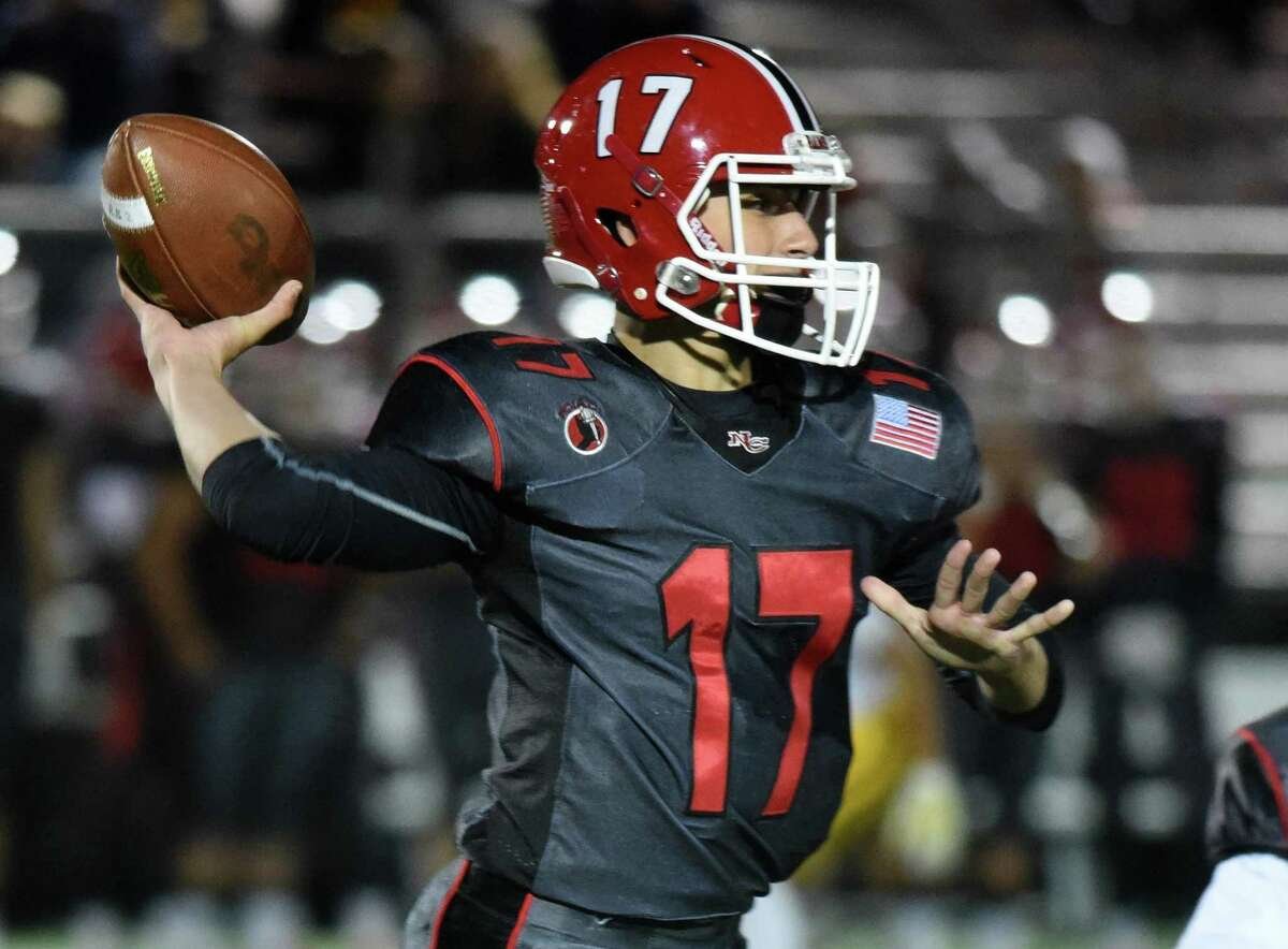 New Canaan's Reid Brown (17) throws a pass during a football game against St. Joseph at Dunning Field in New Canaan on Friday, Oct. 4, 2019.