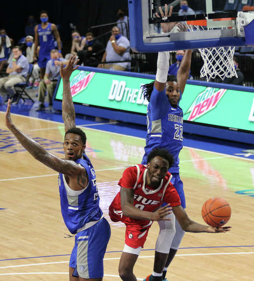 SIUE's Sidney Wilson (middle) draws a foul while trying to put up a shot between Saint Louis' Jimm Bell Jr. (left) and Terrance Hargrove Jr. during a college men's basketball game Wednesday night at Chaifetz Arena in St. Louis. SLU won 89-52 in the season opener for both teams. Wilson, a UConn transfer who led the Cougars with 14 points and seven rebounds, was injured on the play and unable to shoot his free throws. SIUE returns to Chaifetz for a Thanksgiving game against LSU. Photo: Greg Shashack / The Telegraph