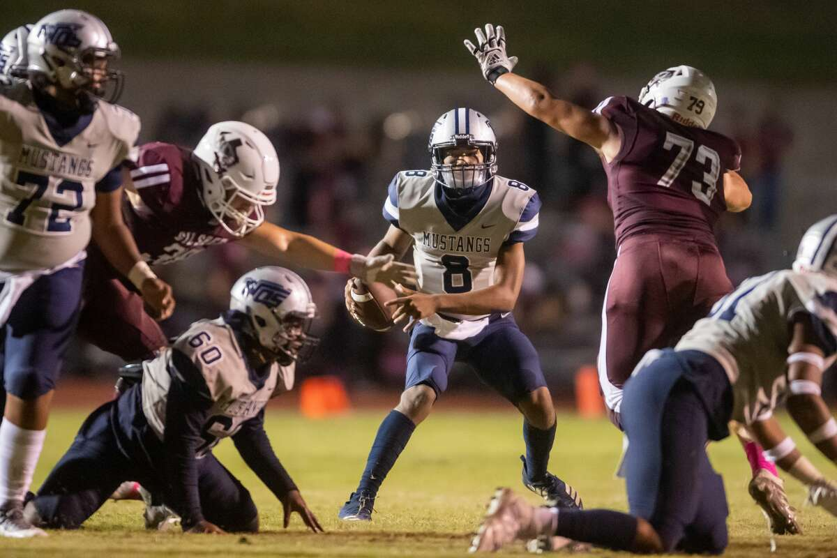 Silsbee's Ayden Bell (73) rushes the WO-S quarterback Jerren Terrell (8) in one of their game during the 2020 season. The Mustangs of West Orange-Stark traveled to Silsbee High School to take on the Tigers on Saturday night. Photo made on October 10, 2020. Fran Ruchalski/The Enterprise