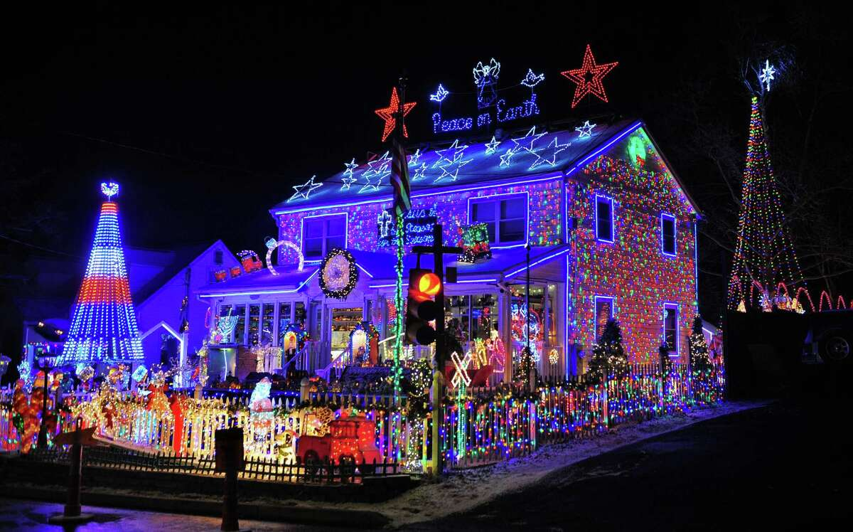 FILE - Wonderland at Roseville lights up the whole block on Roseville Terrace in Fairfield, Conn., taken on Wednesday, Dec. 18, 2019.