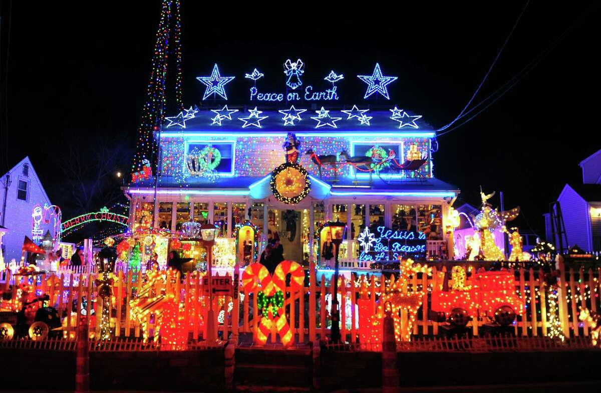 FILE - Wonderland at Roseville lights up the whole block on Roseville Terrace in Fairfield, Conn., taken on Wednesday, Dec. 14, 2016.