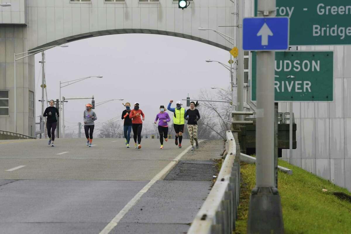 Runners cross the Green Island Bridge in November. (Paul Buckowski/Times Union)