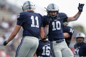 College Park tight end Cody Mladenka (11) celebrates with fullback Michael Perry (10) earlier this season.