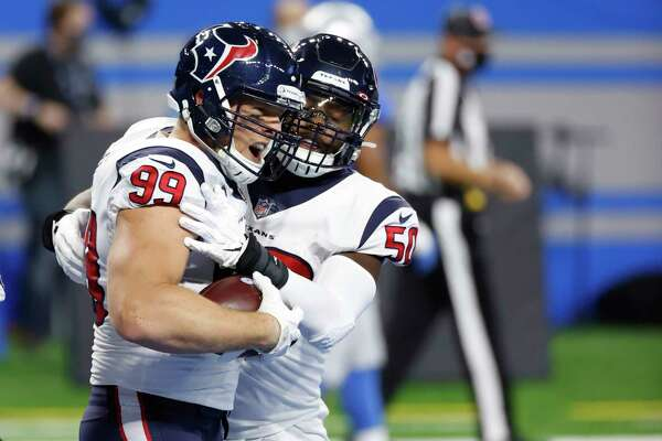 Houston Texans defensive end J.J. Watt (99) receives congratulations from linebacker Tyrell Adams (50) after he makes an interception for a touchdown in the first half against the Detroit Lionsduring an NFL football game, Thursday, Nov. 26, 2020, in Detroit. (AP Photo/Rick Osentoski)